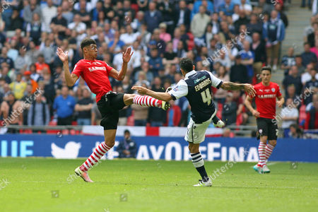 Football - 2016 League One Play-Off Final - Barnsley vs Millwall Ashley Fletcher of Barnsley stretches into the tackle on Carlos Edwards of Millwall at Wembley Stadium