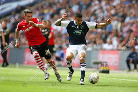 Football - 2016 League One Play-Off Final - Barnsley vs Millwall Carlos Edwards of Millwall and Adam Hammill of Barnsley in action at Wembley Stadium
