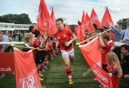 Football - 2015 / 2016 Greene King IPA Championship - London Welsh vs Bristol Seb Jewell of London Welsh enters the pitch for his 100th game as the club return to the Old Deer Park ground