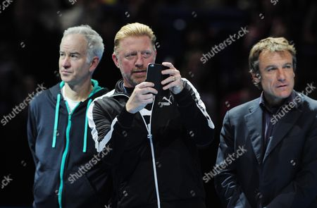 Tennis - 2015 ATP World Tour Finals at The O2 - Day Four Retiring Lleyton Hewitt honoured Former world no 1 Lleyton Hewitt who will be retiring in January is presented with a bottle of champagne and a framed poster highlighting his career achievements Boris Becker films the presentation with John McEnroe and Mats Wilander (right)
