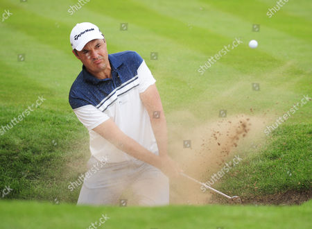 Stock Image of Golf - 2016 BMW PGA Championship [Wentworth] - Round Two Simon Khan of England in a bunker at the 18th