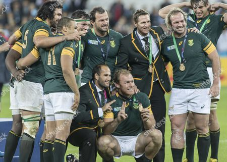 Stock Picture of Rugby Union - 2015 Rugby World Cup - 3rd/4th Place 'Bronze Final': Argentina vs South Africa South Africa's Schalk Burger poses with Fourie du Preez Jannie du Plessis injured Jean de Villiers Bismarck du Plessis and team mates for a group medal picture at Olympic Stadium Queen Elizabeth Olympic Park Stratford  GB London