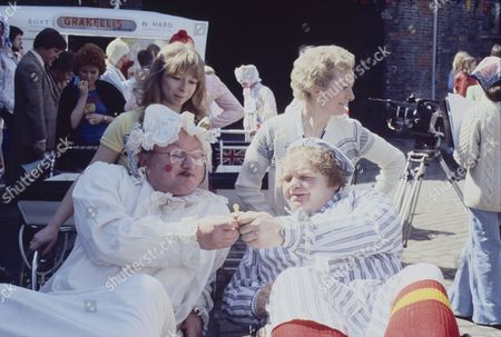 Coronation Street Pram Race. Helen Worth (as Gail Potter) Thelma Barlow (as Mavis Riley) Fred Feast (as Fred Gee) and Geoffrey Hughes (as Eddie Yeats)