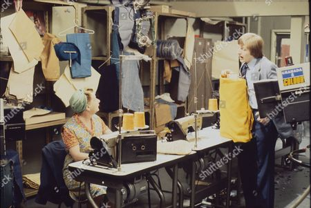 Stock Image of The factory staff go on strike. Jean Alexander (as Hilda Ogden) and Lawrence Mullin (as Steve Fisher)