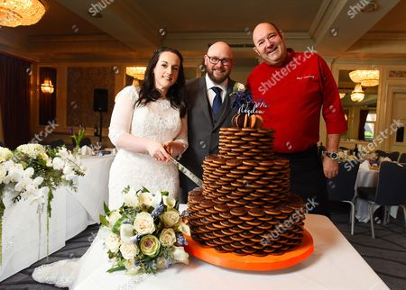 Editorial photo of Couple have specially-made Jaffa Cakes wedding cake, Waltham Cross, Hertfordshire, UK - 17 Nov 2016