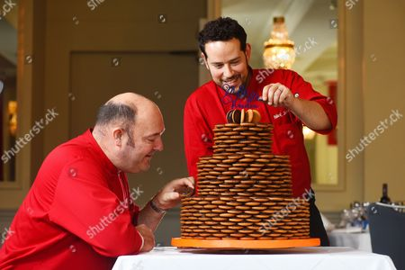 Stock Photo of Paul Courtney (left) and Mark Schomberg (right) putting the finishing touches to the wedding cake