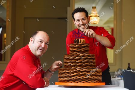 Paul Courtney (left) and Mark Schomberg (right) putting the finishing touches to the wedding cake