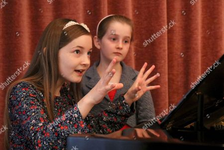 Alma Deutscher, Helen Deutscher In this picture Alma Deutscher and her sister Helen Deutscher, from left, play piano during a rehearsal in Vienna, Austria. Alma Deutscher is a composer, virtuoso pianist and concert violinist who wrote her first sonata five years ago and whose first full opera will have its world premiere next month. All of which is special only because she 11