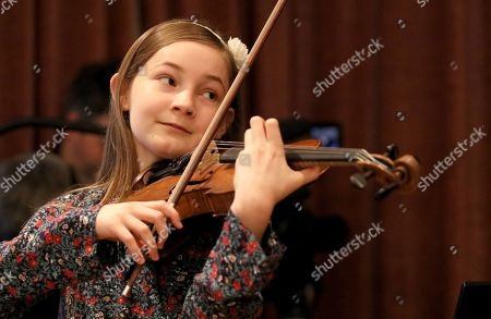 Stock Image of Alma Deutscher In this picture Alma Deutscher plays violin during a rehearsal in Vienna, Austria. Alma Deutscher is a composer, virtuoso pianist and concert violinist who wrote her first sonata five years ago and whose first full opera will have its world premiere next month. All of which is special only because she 11