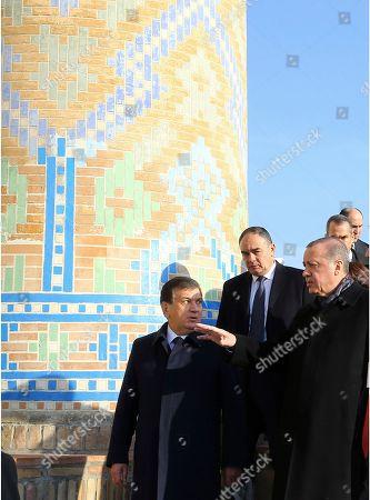 Stock Image of Turkey's President Recep Tayyip Erdogan, right, and Uzbek President Shavkat Mirziyoyev, left, speak as they visit the tomb of late Uzbek president Islam Karimov in Samarkand, Uzbekistan, . Erdogan is in Uzbekistan for a one-day official visit