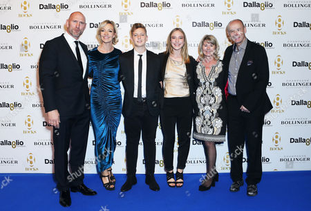 Lawrence Dallaglio with wife Alice, son Enzo, daughter Josie and Clive Woodward and Lady Woodward