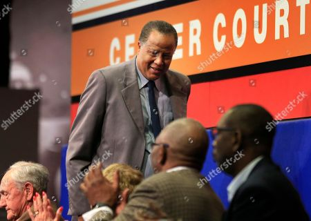 Stock Photo of Jamaal Wilkes Jamaal Wilkes takes his seat after speaking at a college basketball Hall of Fame news conference in Kansas City, Mo., . Wilkes will be formally inducted during ceremonies later tonight