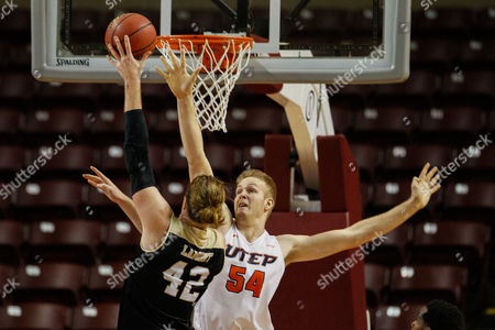 Drake LaMont (42) of the Western Michigan Broncos floats a layup over Kelvin Jones (54) of the UTEP Miners in the Gildan Charleston Classic matchup between the Western Michigan Broncos and the UTEP Miners at TD Arena in Chaleston, SC