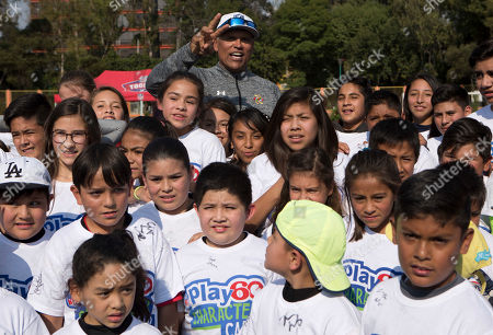 Anthony Munoz Pro Football Hall of Famer Anthony Munoz, who played 13 seasons as offensive tackle for the Cincinnati Bengals, poses for a picture with participants of an NFL-sponsored event promoting physical activity for kids, in Mexico City, . The NFL's Play 60 campaign encourages children to be active 60 minutes a day to avoid childhood obesity