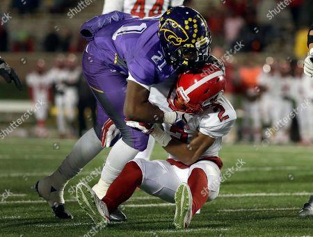 Joe Jordan, Jaylen Ivey Blue Springs' Jaylen Ivey (21) powers past Kirkwood's Joe Jordan (2) on his way to a touchdown during the first half in the Missouri Class 6 state high school football championship, in Columbia, Mo