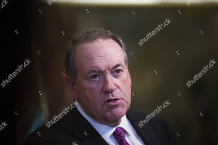 Former Governor Mike Huckabee (Republican of Arkansas) speaks to members of the media inside of the lobby of Trump Tower in Manhattan