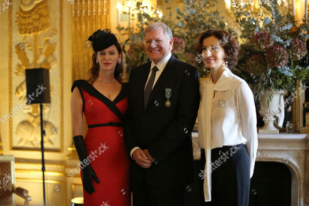 American film director Robert Zemeckis, center, poses with his wife Leslie Harter Zemeckis, left, and French Culture minister Audrey Azoulay, after being awarded with the order of Arts and Letters' medal, in Paris