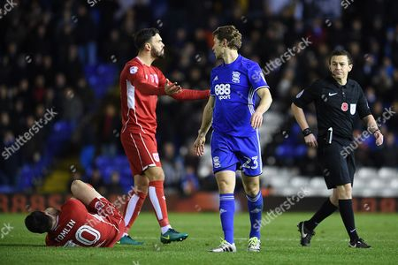 Referee Tony Harrington reaches for his red card to send off Jonathan Spector of Birmingham City after his challenge on Lee Tomlin of Bristol City  the Sky Bet Championship match between Birmingham City and Bristol City played at the St Andrews Stadium, Birmingham on 19th November 2016