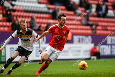 Charlton Athletic defender Morgan Fox (21)  turns away from Port Vale midfielder Sam Kelly (7) during the EFL Sky Bet League 1 match between Charlton Athletic and Port Vale at The Valley, London