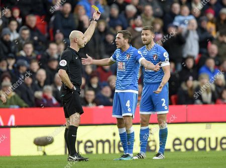 Dan Gosling of Bournemouth is booked by referee Roger East during the Premier League match between Stoke City  and Bournemouth played at The bet365 Stadium, Stoke-on-Trent, Saturday the 19th of Novemeber 2016