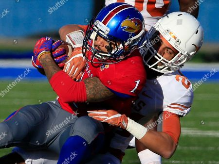 LaQuvionte Gonzalez, John Bonney Kansas wide receiver LaQuvionte Gonzalez (1) is tackled by Texas cornerback John Bonney (24) during the first half of an NCAA college football game in Lawrence, Kan