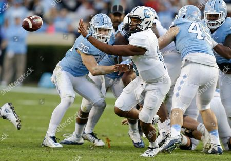 Stock Image of Dominique Allen The Citadel quarterback Dominique Allen tosses the ball during the first half of an NCAA college football game against North Carolina in Chapel Hill, N.C