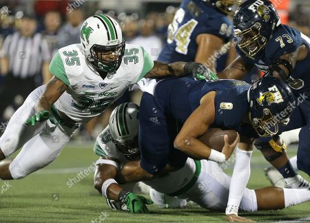 Christian Alexander, Frankie Hernandez, Gary Thompson Florida International quarterback Christian Alexander (8) is sacked by Marshall defensive lineman Gary Thompson (59) during the first half of an NCAA college football game, in Miami. At left is Marshall linebacker Frankie Hernandez