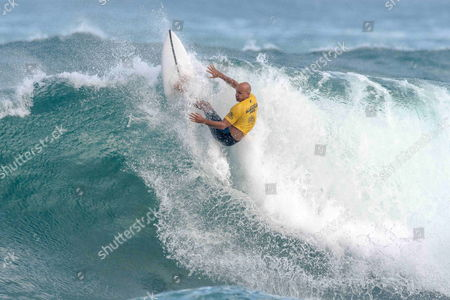 Pro Surfer Kelly Slater during action at the final contest day of the Hawaiian Pro Contest at Haleiwa on the North Shore of Oahu, Hawaii which was won by newly crowned World Champion John John Florence . This completes the first jewel of the Vans Triple Crown of Surfing which continues next with the Vans World Cup of Surfing at Sunset Beach and ends with the Billabong Pipeline Masters. - Steven Erler/CSM