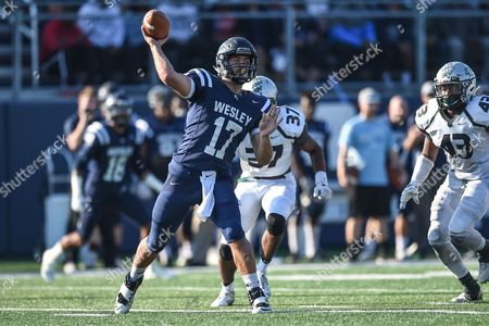 Wesley quarterback Nick Falkenberg (17) passes during the NCAA playoff matchup between the Stevenson Mustangs and the Wesley Wolverines at Scott D. Miller Stadium in Dover, De. The Mustangs made their first NCAA playoff appearance but were defeated by the Wolverines 38-17