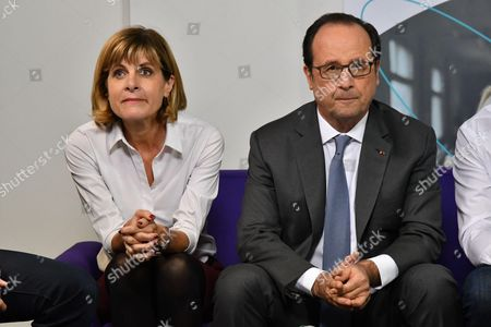 Stock Picture of French President Francois Hollande along with Sigfox president of the board of directors Anne Lauvergeon during a visit to the headquarters of Sigfox company at the IoT Valley (Internet of Things) startup accelerator in Labege