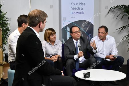 French President Francois Hollande along with Sigfox founder and IoT Valley CEO Ludovic Le Moan and Sigfox president of the board of directors Anne Lauvergeon during a visit to the headquarters of Sigfox company at the IoT Valley (Internet of Things) startup accelerator in Labege