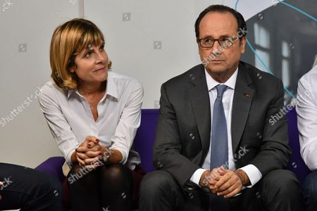 Stock Photo of French President Francois Hollande along with Sigfox president of the board of directors Anne Lauvergeon during a visit to the headquarters of Sigfox company at the IoT Valley (Internet of Things) startup accelerator in Labege