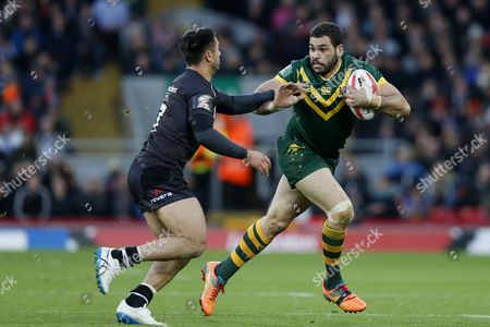 Greg Inglis of Australia is tackled by Shaun Johnson of New Zealand during the Ladbrokes Four Nations match between Australia and New Zealand played at Anfield, Liverpool on 20th November 2016