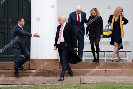Kellyanne Conway, Mike Pence, Charlotte Pence, Donald Trump President-elect Donald Trump, second left, is guided by a member of his security detail, left, as he and Vice President-elect Mike Pence, center, his daughter Charlotte and Kellyanne Conway, right, leave services at Lamington Presbyterian Church in Bedminster, N.J