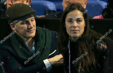 German footballer Bastian Schweinsteiger and girlfriend Ana Ivanovic arrive in the tribune to watch the ATP World Tour Finals singles final tennis match between Andy Murray of Britain and Novak Djokovic of Serbia at the O2 Arena in London