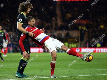 Middlesbrough's Gaston Ramires, right, vies for the ball with Chelsea's David Luiz, right, during the English Premier League soccer match between Middlesbrough and Chelsea at the Riverside stadium, Middlesbrough, England