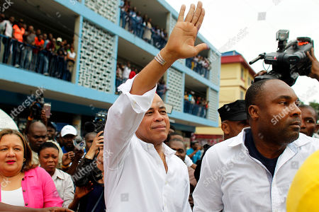 Michel Martelly Haiti's former President Michel Martelly greets supporters after voting in the Petion-Ville suburb of Port-au-Prince, Haiti, . Haiti's repeatedly derailed presidential election got underway more than a year after an initial vote was annulled