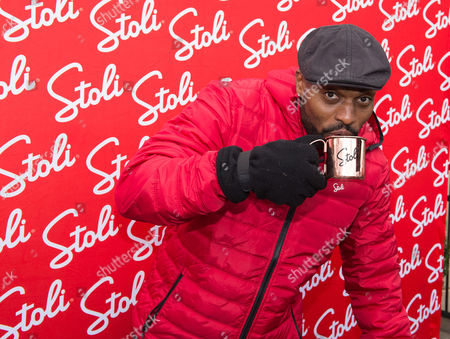 Stock Photo of Amani Toomer World Champion Amani Toomer enjoys his signature Stoli cocktail, The Big Blue Mule, at THE Ultimate #Cocktailgating Experience by Stoli Vodka on in Carlstadt, N.J