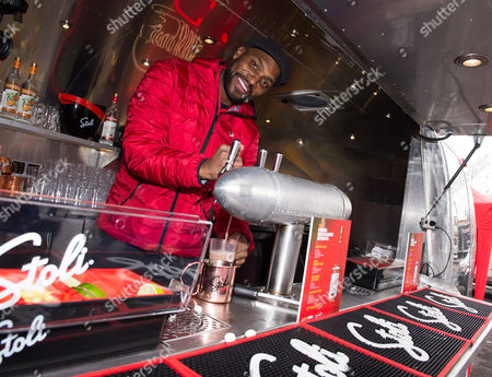 Amani Toomer World Champion Amani Toomer serves fans his signature Stoli cocktail, The Big Blue Mule, during THE Ultimate #Cocktailgating Experience by Stoli Vodka on in Carlstadt, N.J
