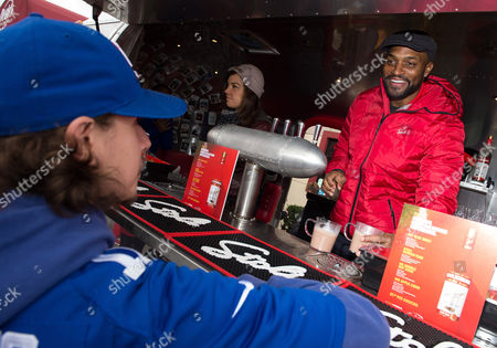 Stock Image of Amani Toomer World Champion Amani Toomer serves fans his signature Stoli cocktail, The Big Blue Mule, during THE Ultimate #Cocktailgating Experience by Stoli Vodka on in Carlstadt, N.J
