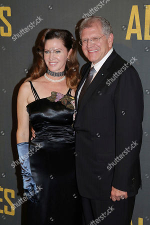 American film director Robert Zemeckis, right, poses with his wife Leslie Harter Zemeckis during the photocall for his new film 'Allied' of director Robert Zemeckis, in Paris