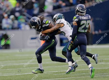 Richard Sherman, Earl Thomas, Bryce Treggs Seattle Seahawks cornerback Richard Sherman, left, is tackled by Philadelphia Eagles wide receiver Bryce Treggs, center, after Sherman intercepted a pass intended for Treggs in the second half of an NFL football game, in Seattle