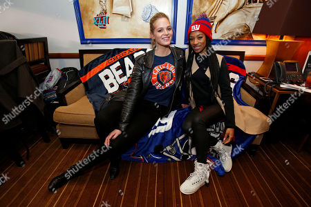 Erin Heatherton and Briana Thevenin, right, sister of Victor Cruz, enjoy friendly rivalry at the NY Giants vs. Chicago Bears game at Metlife Stadium on . Both are sporting NFL Women's Apparel and wrap blankets from The Northwest, available on NFLShop.com