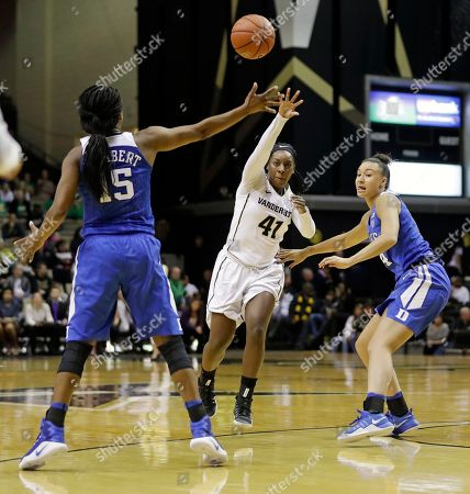 Miaya Seawright, Kyra Lambert, Faith Suggs Vanderbilt guard Miaya Seawright (41) passes between Duke defenders Kyra Lambert (15) and Faith Suggs, right, in the first half of an NCAA college basketball game, in Nashville, Tenn