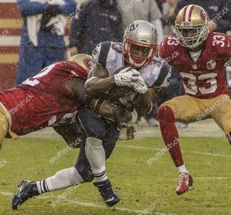 San Francisco 49ers defensive end Quinton Dial (92) tackles New England Patriots running back Dion Lewis (33) on Sunday, , 2016, at Levis Stadium in Santa Clara, California. The Patriots defeated the 49ers 30-17