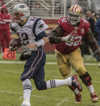 San Francisco 49ers defensive end Quinton Dial (92) rushes New England Patriots quarterback Tom Brady (12) on Sunday, , 2016, at Levis Stadium in Santa Clara, California. The Patriots defeated the 49ers 30-17