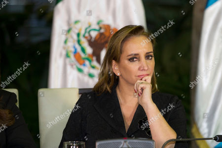 Mexico's Foreign Affairs Minister Claudia Ruiz Massieu listens to El Salvador's Foreign Minister Hugo Martinez during a press conference in Guatemala City, . The foreign ministers of Mexico, El Salvador, Honduras and Guatemala met to coordinate their position regarding U.S. immigration deportation policies announced by President-elect Donald Trump