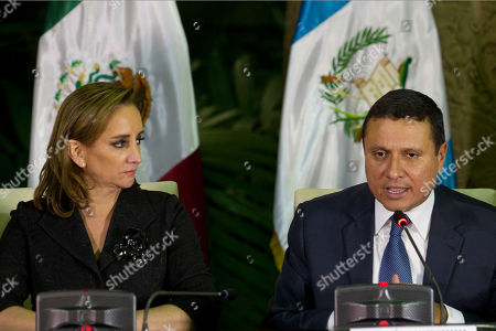 Mexico's Foreign Affairs Minister Claudia Ruiz Massieu listens to Guatemala's Foreign Minister Carlos Raul Morales during a press conference in Guatemala City, . The foreign ministers of Mexico, El Salvador, Honduras and Guatemala met to coordinate their position regarding U.S. immigration deportation policies announced by President-elect Donald Trump