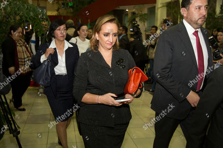 Mexico's Foreign Affairs Minister Claudia Ruiz Massieu, center, arrives for a meeting in Guatemala City, . Foreign ministers of Mexico, El Salvador, Honduras and Guatemala meet to coordinate their position regarding US immigration deportation policies announced by President-elect Donald Trump