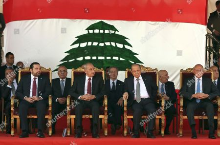 From left to right, Lebanese Prime Minister designate, Saad Hariri, Parliament Speaker Nabih Berri, President Michel Aoun, and caretaker Prime Minister Tammam Salam, attend a military parade to mark the 73rd anniversary of Lebanon's independence from France in downtown Beirut, Lebanon, . Lebanon gained independence from France in 1943